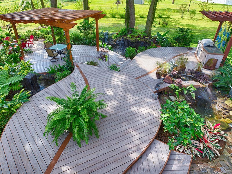 Deck with plants, furniture, and outdoor grill
