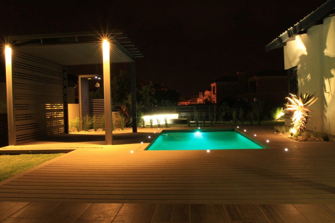 Illuminated pool and decking at night
