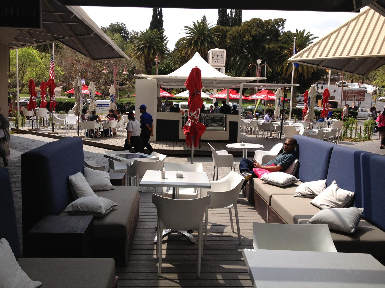 Decking with outdoor furniture and people