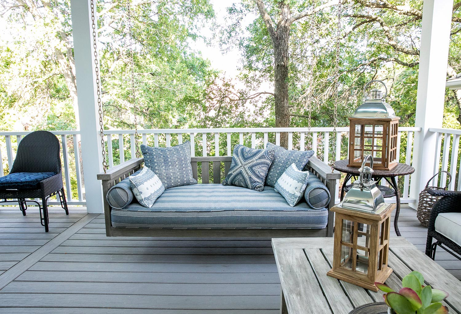 Outdoor deck with bench swing and furniture