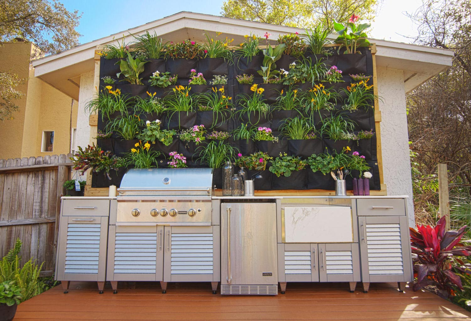 Outdoor grill with deck and hanging flowers