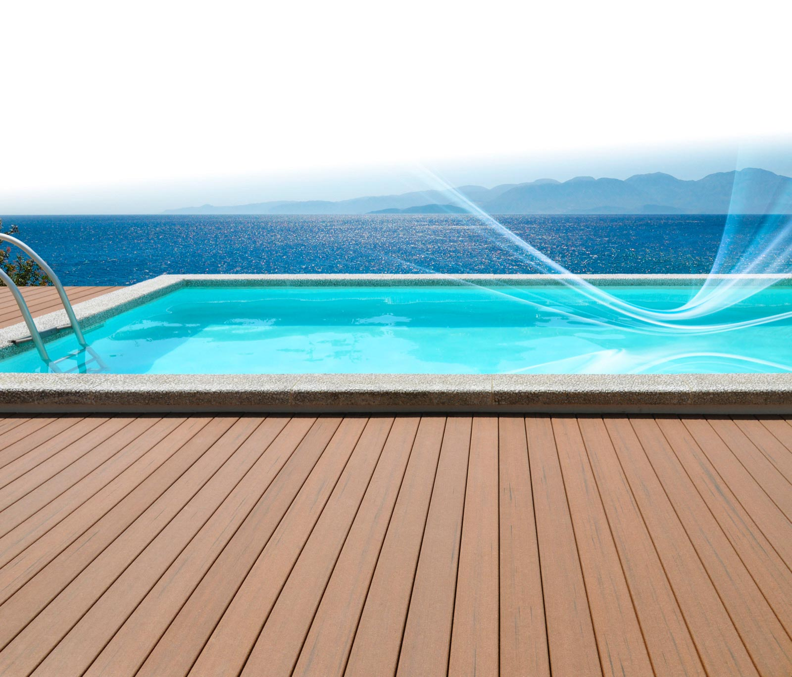 Pool with decking overlooking ocean