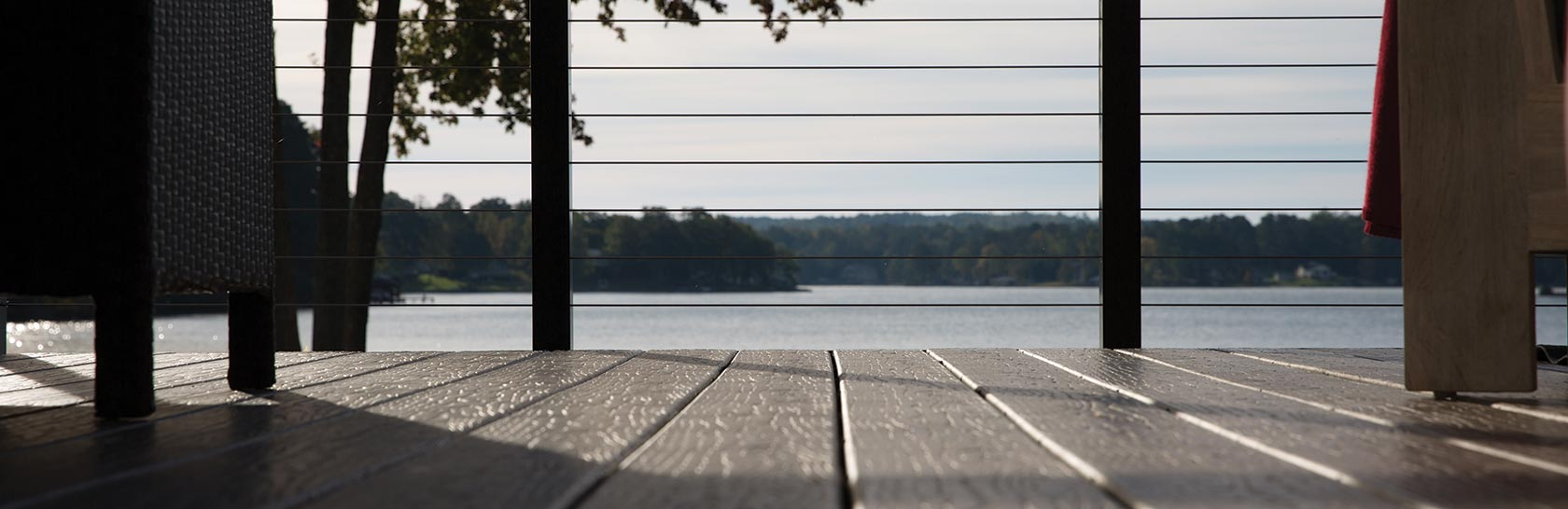 Close up of MoistureShield composite decking and a view of a lake.